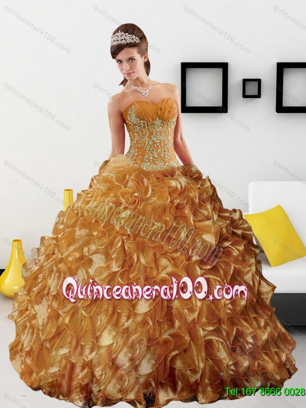 e497e57e4d26 Sturning Appliques and Ruffles 2015 Wholesale Quinceanera Dress in Gold.  triumph