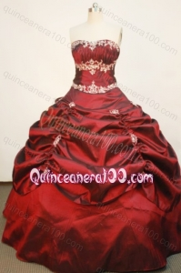 Popular Wine Red Ball Gown Strapless Quinceanera Dress With Pick-ups And Appliques