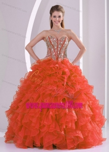 Ball Gown Sweetheart Ruffles and Beaded Decorate Coral Red Quinceanera Gowns