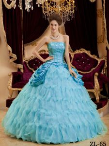Strapless Aqua Blue Quinces Gown with Ruffles and Lace-up back