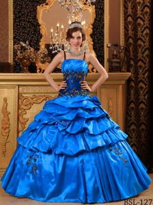 Blue Dresses for Quinces with Spaghetti Straps and Appliques