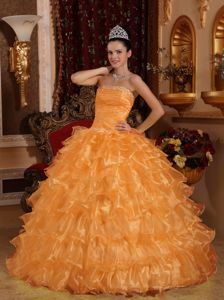 Orange Ruched Strapless Quinces Dresses with Ruffles and Beading