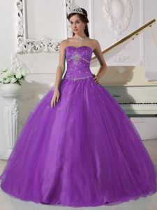 Beaded Strapless Floor-length Ruched Quinceanera Dress in Purple