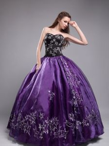 Eggplant Purple and Black Quinceanera Dress with Star Embroidery