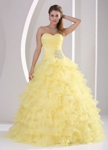 Light Yellow Appliques and Ruching Quinceaneras Gowns with Ruffles