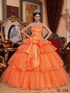 Classy Ruffled Orange Red Dress for Sweet 15 with Big Bowknot
