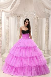 Rose Pink and Black Quinceanera Gown Dress with Ruffled Layers