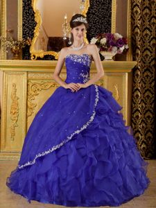 Deep Purple Strapless Quinceanera Dress with Appliques and Ruffled Skirt