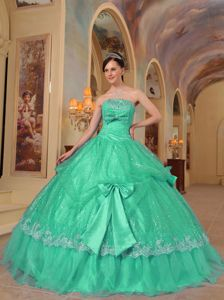 Fashionable Green Dresses for a Quince with Sequins and Bowknots
