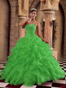 Ruched and Beaded Green Organza Dresses for A Quince with Ruffles
