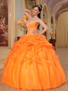 Orange Sweetheart Dresses for A Quince with Pick ups and Appliques