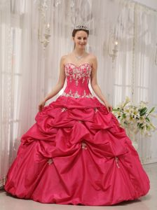 Sweetheart Coral Red Quinceanera Gown with Ruffles and Appliques