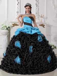 Blue and Black Sweet 15 Dress with Ruffles and Rolling Flowers