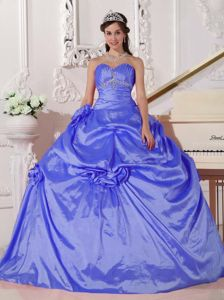 Blue Quinceanera Gown with Beading and Hand Made Flowers in Taffeta