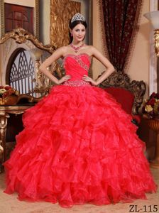 Red Sweetheart Quinceanera Dress in with Beading and Ruffles