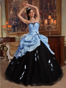 Light Blue and Black Quinceanera Gown with Pick Ups and Ruched bodice