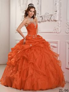 Orange Red Ruffled Dress for Quince with Appliques and Pick-ups