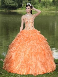 Best Orange Ruffled Layers Strapless Quinceanera Gown with Beading