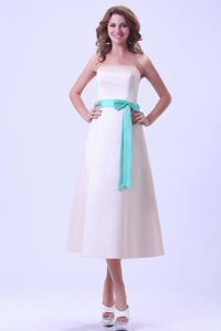 Champagne Tea-length Satin Dama Dress With a Turquoise Sash