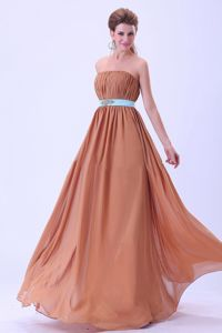Chocolate Dama Dress With a Blue Belt and Ruches in Chiffon